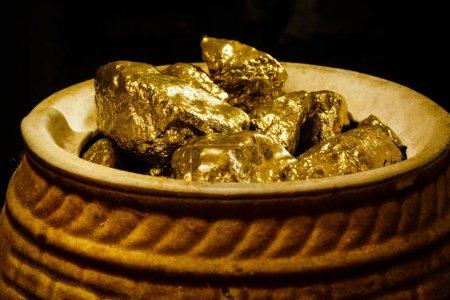 Mound of gold on black background, close up
