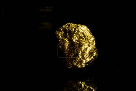 Closeup of big gold nugget on black background