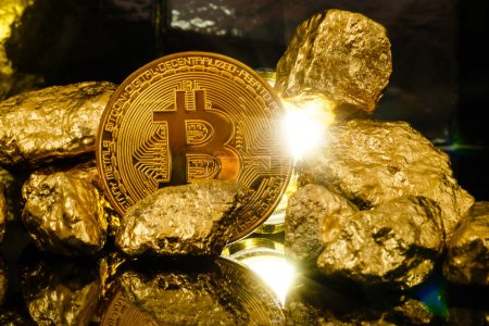 Bitcoin and mound of gold nuggets, crypto currency concept