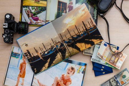 Album with photos of travel and vintage old camera on a background