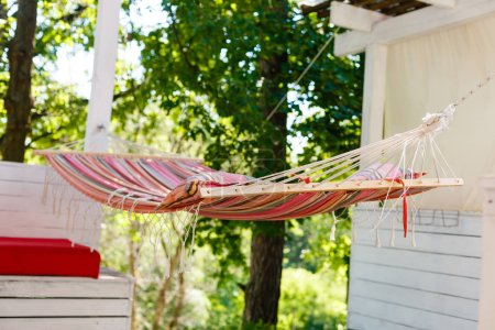 A stripped hammock hanging in the garden
