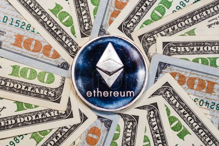 Ethereum crypto currency on dollar banknotes