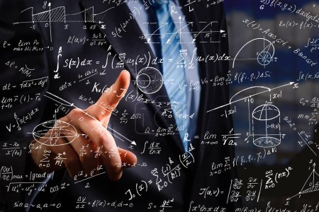 Side portrait of handsome young businessman writing mathematical formulas on bright city background