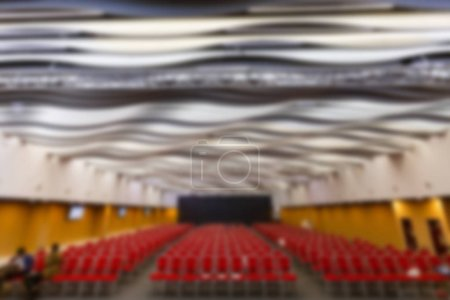 Blur of business conference and presentation in conference hall
