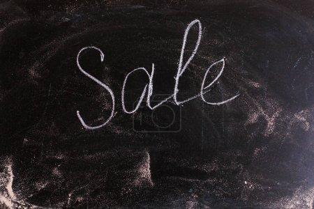 Blackboard with sale written on it