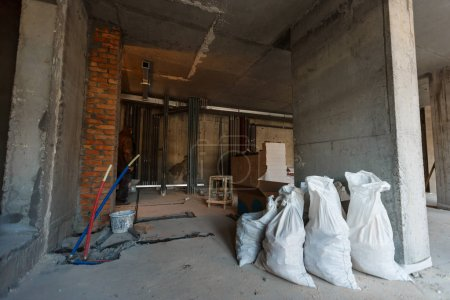 Interior of apartment with materials during on the renovation and construction remodel wall from