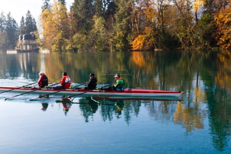 Thun, Switzerland - October 30, 2017: men oarsmans on the lakerowing during sunny day