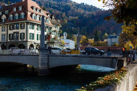 Thun, Switzerland - October 30, 2017: street with people and cars sunny day