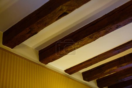 Wooden beams hold the ceiling