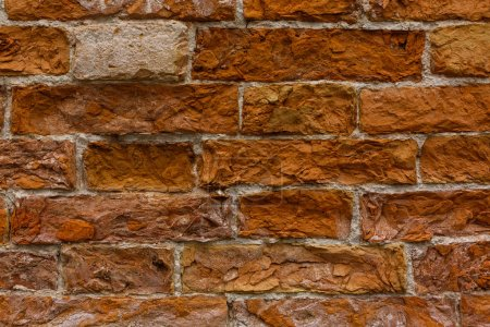 Red Clay Brick Wall Old Texture. Grungy Brickwall Horizontal Background.Damaged House Facade