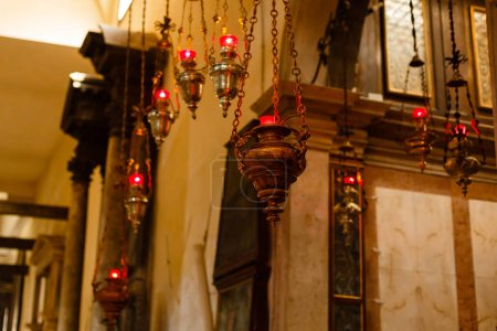 iron censer hanging above icon in Church