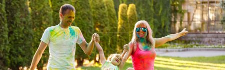 Photo for Happy family of three young people in the park - Royalty Free Image