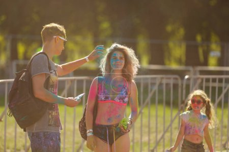 Kiev, UKRAINE - August 13, 2017: Portrait of happy young girl on holi color festival