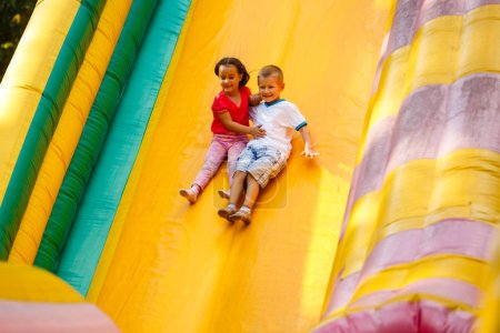 Photo for Jumping kids on colorful trampoline - Royalty Free Image