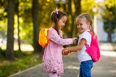 Photo for Two little kids going to school together - Royalty Free Image