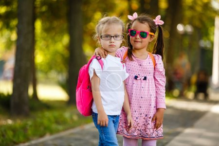 Photo for Happy Schoolgirls outdoor. Back to School - Royalty Free Image