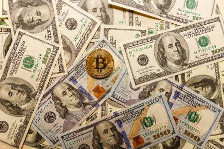 Golden bitcoin on us dollar bills electronic money exchange concept