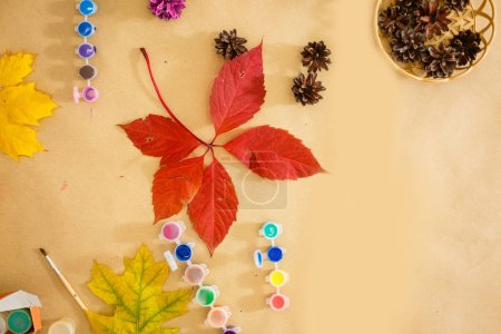 Photo for Paint for coloring leaves and cones. Autumn background about creativity, return to school. Save the space back to school - Royalty Free Image