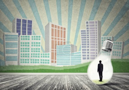 Photo for Businessman inside light bulb against city drawn concept - Royalty Free Image