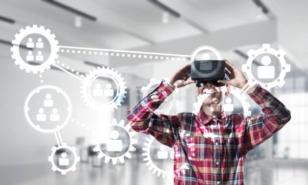 Photo for Young man with virtual reality headset or 3d glasses over social connection background - Royalty Free Image