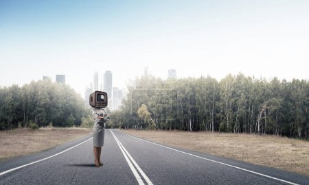 Business woman in suit with an old TV instead of h...