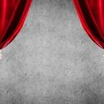 Close up of businessman hand open red velvet curta...
