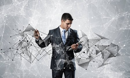 Photo for Businessman with documents pointing on abstract network structure. Standing personal assistant in business suit and tie on white background. Global cloud technology and internet communication - Royalty Free Image