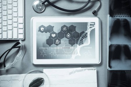 Photo for White tablet pc and doctor tools on gray surface - Royalty Free Image
