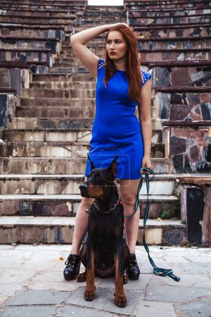 Best friends young redheaded girl and her dog dobe...