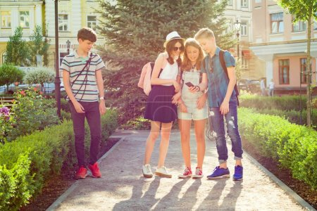 Photo for Group of happy teenagers friends 13, 14 years walking along the city street. Friendship and people concept - Royalty Free Image