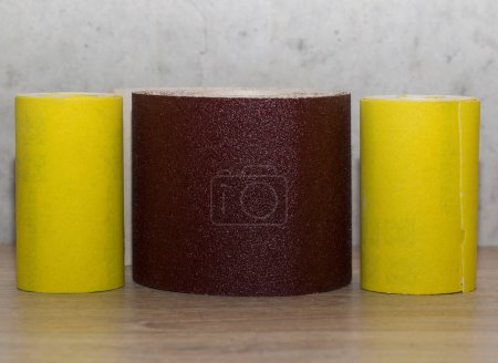 Roll of brown and yellow sandpapers