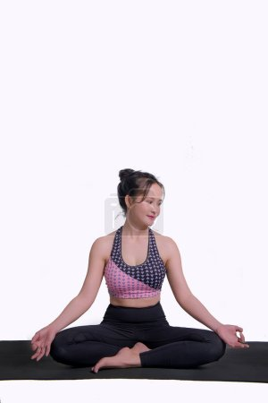 Photo for Young woman practicing yoga To strengthen the shape of meditation strength in the whtie background - Royalty Free Image