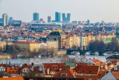 Prague, Czech Republic - April 09, 2018: Aerial view at the scenic cityscape with National Theatre, Vltava river and skyscrappers on horizon