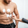 Male athlete does a cardiac stress test....