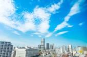 """Постер, картина, фотообои """"Концепция бизнеса Азия недвижимости и корпоративного строительства - панорамный современный город городской пейзаж воздушные птичьего под солнцем & синий небо в Токио, Япония"""""""