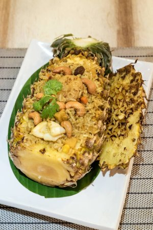Pineapple fried rice serve in whole pineapple