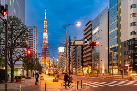 Photo for Tokyo Tower at dusk with Tokyo skyline city scape in monato ward. Tokyo Tower is famous landmark height 332.9 metres, the second-tallest tower in Japan. - Royalty Free Image