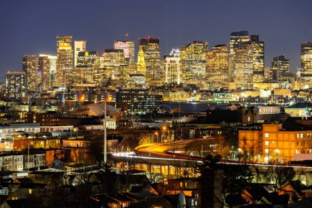 Photo for Boston Cityscape with highway trail to Boston MA USA at night. - Royalty Free Image