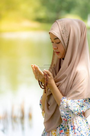 Photo for Young Adult teenager Woman making Duas for Muslim god blessing prayer. - Royalty Free Image