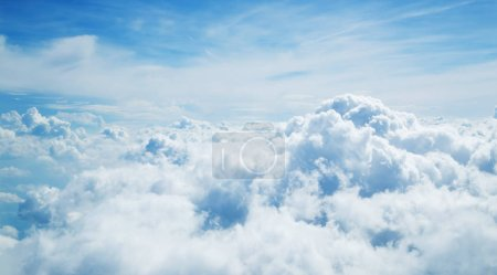 Above the clouds. Beautiful above sky panoramic view from airplane
