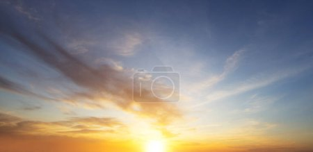Photo for Beautiful sunset sky with clouds and falling sun - Royalty Free Image