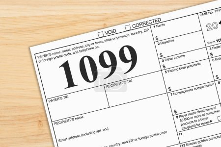 Photo for A US Federal tax 1099 income tax form on a desk - Royalty Free Image