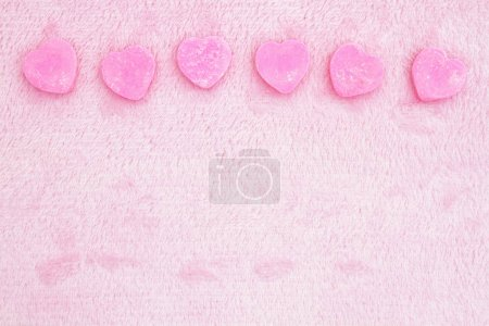 Photo for Pink love background with pink fabric and candy hearts background - Royalty Free Image