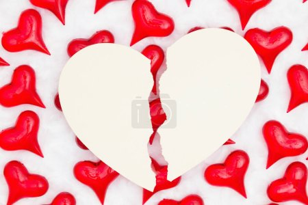 Photo for Broken heart card with red hearts on white fabric background with copy space for your message - Royalty Free Image
