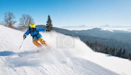 Photo for Shot of a professional skier riding the slope in a beautiful winter day copyspace ski resort recreation travelling tourism vacation extreme adrenaline - Royalty Free Image