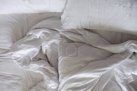 Messy Bed. White Pillow and Blanket in Bedroom, Relaxation and Comfortable Concept