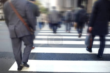 Photo for Blurred Motion Business People Crossing Street in City, Hurry Rush Hour in Metropolis - Royalty Free Image