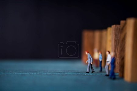 Photo for Leadership Concept. Miniature Figures of Businessmen Leading from another by Stepping Forward - Royalty Free Image