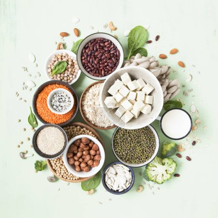 Photo for Vegetable albumen sources. Plant protein (beans, nuts, vegetables, mushrooms, seeds) forming a circle. Vegan and vegetarian food concept. Flat lay. - Royalty Free Image