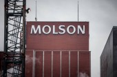 MONTREAL, CANADA - NOVEMBER 5, 2018: Molson Coors logo on Molson Brewery brick tower in downtown Montreal, Quebec. It is one of the biggest beer producers in the world, & a landmark